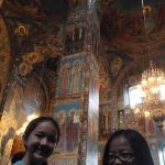 And inside two smiling girls standing on the spot of spilled blood.