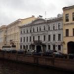 Pushkin's house adjacent to our hotel... The yellow building on the left with the bus in front.