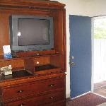 TV area showing door to balcony.