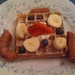 From scratch wild rice waffles, fruit, and Conecuh sausage (starter was sweet baked apples)