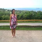 In front of Coffee Care, Capital Hill, Saipan, with Managaha Island in the background, Christmas