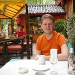 Getting free brunch outside our hotel in Lijiang.