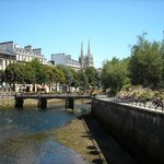 The Odet river at low tide with the Saint-Corentin cathedral in the background, Quimper.