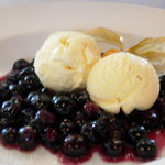 Dessert, sauted blueberries with vanilla ice cream