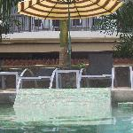 Tiled loungers in the water, deluxe loungers poolside.