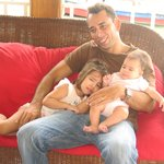 Gabriel and his two daughters in the hotel lobby