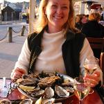 Enjoying oysters, a dry white and sunset in Cancale.