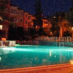 Apartments and pool at night, from the Pool Bar