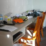 No shelves or drawers so clothes go on the desk