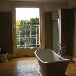 Ensuite bathroom with twin sinks, bath and shower