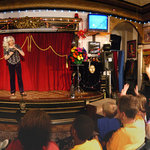 Dorothy performing a card trick for the appreciative visitors