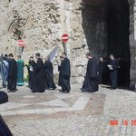 A funeral procession for an Armenian holy man passes through the Zion gate of Jerusalem.