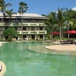 beautiful pool with nice fake sandy beach