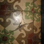 All the floor tiles were cracked and dirty