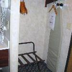Closet area with iron/ironing board