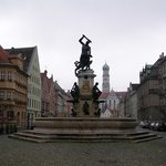 The Hercules Fountain with the former Benedictine abbey church of St. Ulrich and St. Afra on Max