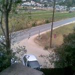 View from a balkony: road and power line