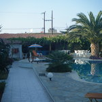 pool and pool bar, main road is directly behind the pool bar