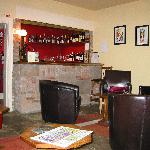 The lounge and very well stocked honesty bar
