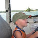 Uriah driving thr Duck on Lake Taneycomo