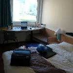 Part of room with bed and working area