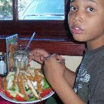 My son with a gigantic crispy chicken salad