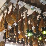 Close up of Serano Hams hanging overhead