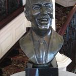 Statue of Walt in restaurant reception.