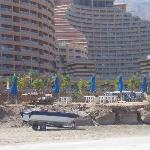 hotel from the beach (below the blue umbrellas) & the residential apartments