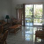 Cool tile flooring and basic yet comfortable furnishings.