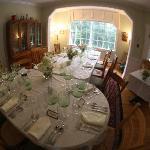Dining room set for dinner.