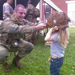 A re-enactor makes a small friend during Currahee Military Weekend, an annual event in October.