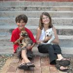 Kids with rescued puppies