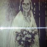 Hologram picture that changes from bride to skelton