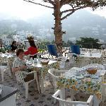 Sue enjoying excellent breakfast at La Tosca.