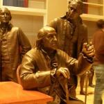 Inside the Constitution Center a statue of Ben Franklin sitting