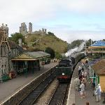 Steam train arriving Corfe Castle