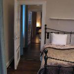 Bedroom looking down corridor to living room