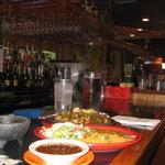 You can eat at the bar & ver el futbol Mexicano