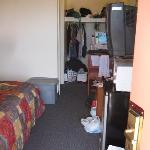 tv, fridge, microwave and storage area
