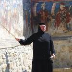 Manastirea Moldovita - a nun during a guided tour