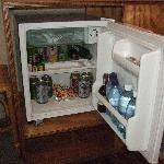 Stocked minibar with snacks and drinks