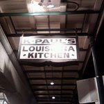 The sign that hangs above the entrance of K-Paul's - you could definitely miss this place if not