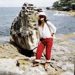 Christine next to an old boulder on a Sydney Beach