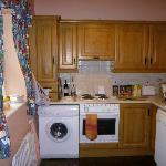 Kitchen with all you need, including dish washer..