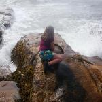 Our little mermaid is mesmerized by the crashing waves.