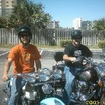 Randy & Timmy on Harley's in parking lot  at Top of the Gulf