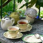 Enjoying tea on our little porch overlooking the gardens...