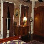 Exposed brick wall, quilt and historic decor