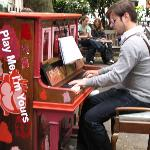 London, playing Piano on the street